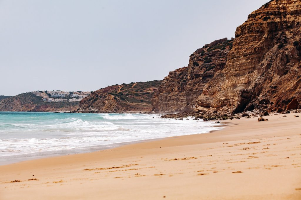 Beautiful view of the sea waves from the rocks in algarve, Portugal